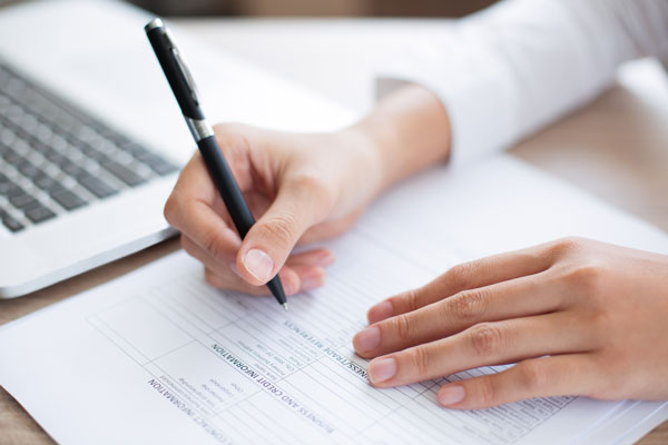 closeup-business-person-completing-form