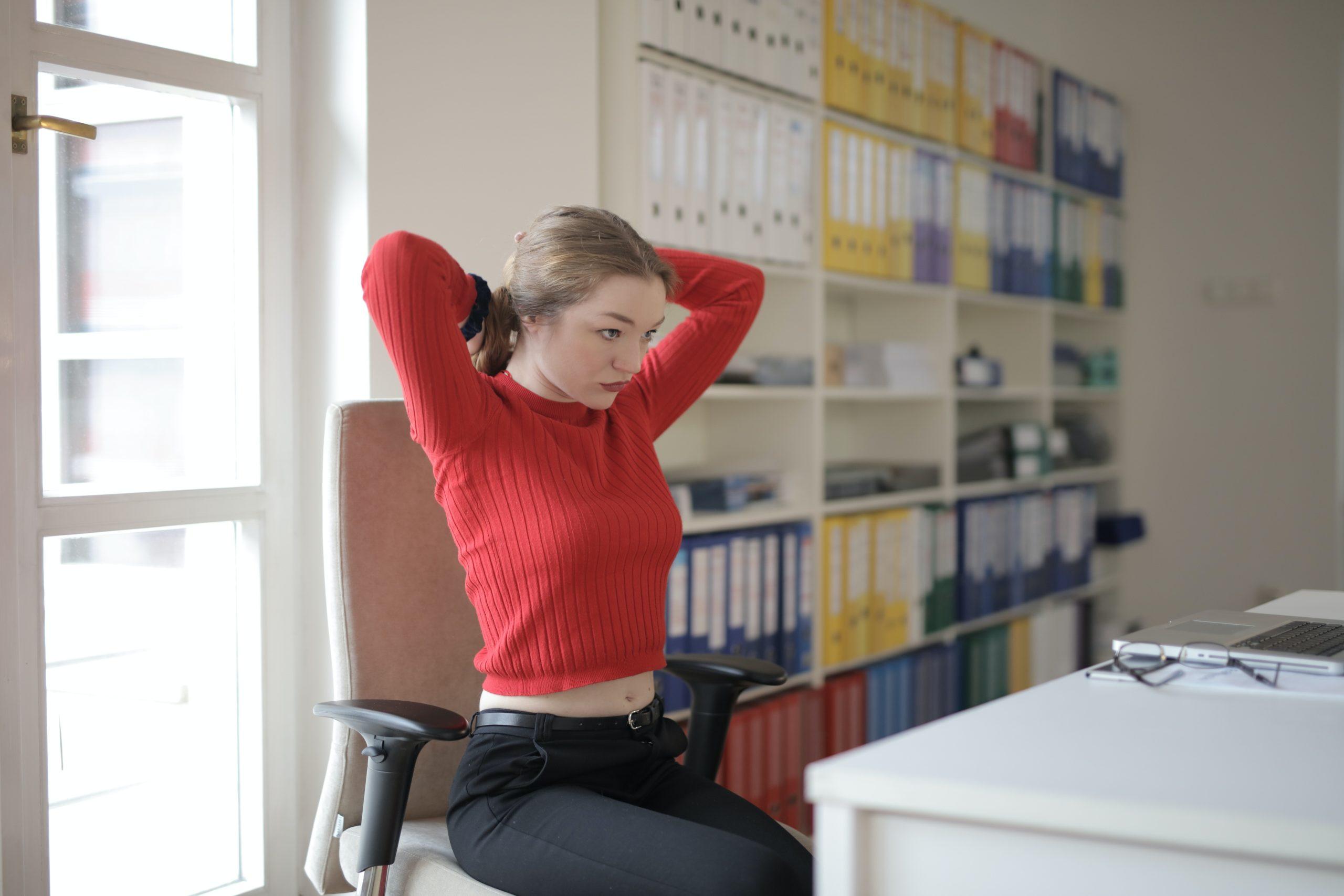 female-employee-tying-hair-in-office-3791539